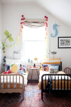 Small shared coed bedroom. I like the dragonflies and seahorses. Very gender neutral