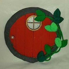 Red Fairy Door with Vines. www.teeliesfairygarden.com . . . This red fairy door with vines can also be a Beautiful Christmas door; just imagine the number of ways this can beused by your fairies in your garden. Always magical! #fairydoor