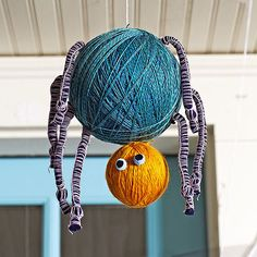 Yarn-wrapped Styrofoam balls become friendly spiders when you add a set of eyes and some dangly legs!
