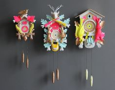 The bright Neons work so well in the design of these cuckoo clock. I would totally have one of these on my walls.
