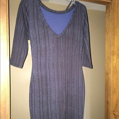 3/4 Sleeve T Shirt Dress with Plunging Back. Never been worn navy patterned dress.  Front has a traditional scoop neck and the back (shown in picture) plunges down. Rachel Roy Dresses Mini