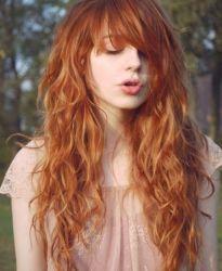 Wavy hair with bangs. Long hair life.
