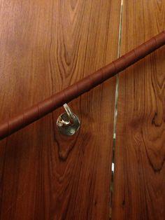 Harcourt London- Ed Tanner leather, overlapped tennis racket style handrail