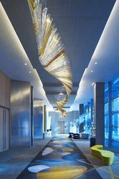 Blue and yellow at Sofitel Dubai Hotel by Wilson Associates Hotel Restaurant, Restaurant Design, Dubai Hotel, Dubai Uae, Interior Lighting, Lighting Design, Lobby Interior, Industrial Lighting, Modern Lighting