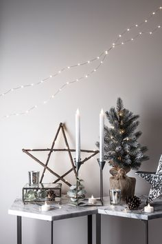 Give your home a festive forest feel with our wooden Calgary star, mini Christmas tree and warm white micro lights.