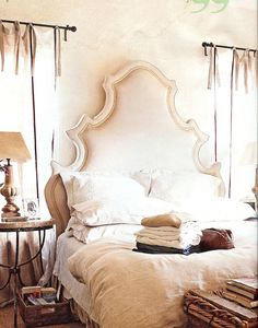 Custom made upholstered headboard in a Venetian shape.  Casual linen tie curtains.  Light and breezy #BedRoom.