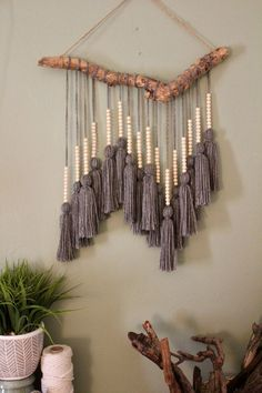 Easy driftwood Macrame hanging Driftwood foundation was found washed up on the coast of Florida near Fort Lauderdale beach. Yarn was individually measured, cut, and tied to create one single tassel. Small wooden beads were then Home Crafts, Diy And Crafts, Arts And Crafts, Yarn Crafts, Diy Yarn Decor, Decor Crafts, Kids Crafts, Macrame Projects, Craft Projects