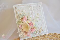 Elegant, subtly coloured card with lots of delicate diecuts.