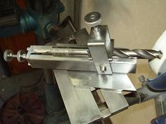 Drill Sharpening Jig by th62 -- Homemade drill sharpening jig constructed from square and round bar stock, steel plate, washers, and Allen bolts. http://www.homemadetools.net/homemade-drill-sharpening-jig