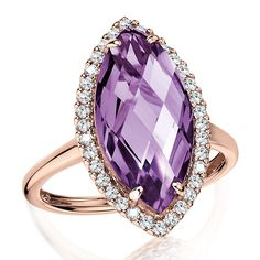 Marquise Amethyst & Diamond Statement Ring in 14K Rose Gold with a marquise-cut Amethyst framed by white Diamonds set in 14k rose Gold. Marquise 18x9 mm center. •$1,599.00