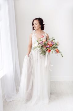 Bright and colorful organically style bridal bouquet. Orange, coral, pick and greenery. Tulips, ranunculus, sweet pea, jasmine. Loose and flowy bouquets. Spring bridal bouquets. Floral- Wildflowers LLC Photography- Rebecca Denton Photography, Backdrop- Telicia Lee