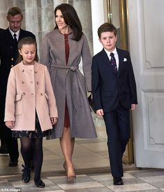 All grown up:Dressed in their finest formal wear, the pair walked proudly beside their mother as they entered Christiansborg Palace for the event