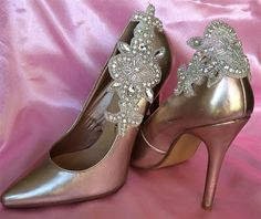 Crystal Fleur Applique Shoe Clips  Beautiful French inspired design with crystals.  They are a flexible and can be worn on the side or back of your shoes and are secured with 2 clips. Size 14 x 5cm. Sold in pairs        Price £21.95