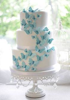 Weave in these magical and breathtaking butterfly wedding ideas on your wedding gown, reception decor, and even the cake! The butterfly teaches the magic of believing. A butterfly wedding is one of the most magical and romantic wedding themes ever. Pretty Cakes, Cute Cakes, Beautiful Cakes, Amazing Cakes, Bolo Laura, Royal Blue Wedding Cakes, Purple Wedding, Lace Wedding, Summer Wedding