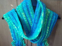 Bright blue and green crocheted scarf with fringe by softtotouch, $20.00