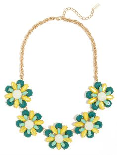 This decadent necklace is a colorful feast for the eyes, flaunting shades of mint, yellow and teal and a darling floral motif the look is bold and blooming.