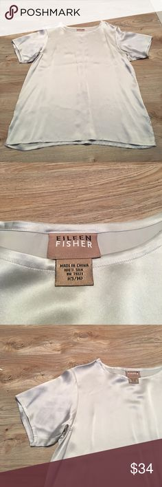 Eileen Fisher 100% silk, silver short sleeve, S/M Beautiful Eileen Fisher silver colored 100% silk top. Tag says small/medium. Depending on how you'd like it to do, it'll be a little looser on a small. Really good condition, two very tiny snags can be seen in the last picture but they're the size of a pencil tip, very small. Price reflects those Eileen Fisher Tops Blouses