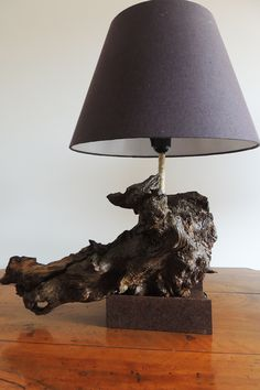 This #lamp is made in Italy with #wood from Central Italy and with a antique iron base.