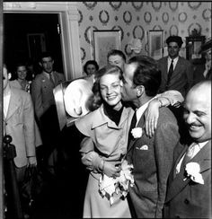 """Lauren Bacall & Humphrey Bogart on their wedding day (1945, photo by Ed Clark for LIFE) Bacall: """"In the bathroom I could hear the start of the Wedding March. Oh God, why hadn't they waited? Later George told me Bogie looked up and said, 'Where is..."""