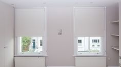 Blackout roller blinds in white   Fitted to bedroom sash windows   Fulham, London   Modern blinds   Made to measure   Made in UK