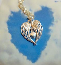 A Piece of my Heart is in Heaven Hanging Charm Angel Wings and Heart Gift Memorial Remembrance Sympathy Gift by JanbroCharmingGifts on Etsy Remembrance Gifts, Sympathy Gifts, Tiny Heart, Memorial Gifts, Organza Gift Bags, Piece Of Me, Angel Wings, Christmas Tree Decorations, Handmade Items