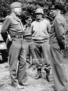 Lieutenant General George Patton, commander of the United States Third Army, Lieutenant General Omar Bradley, commander of the United States Army Ground Forces in France, and Field Marshal Bernard Montgomery, Deputy Commander of Allied Forces in France, discuss battle plans during World War Two on 16th August 1944.