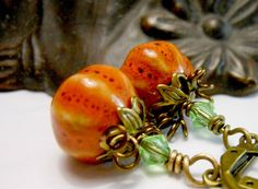 Precious Pumpkin Earrings Holiday Fall Autumn Halloween Orange Holiday Brass Teacher Gift Vintage Style Thanksgiving Gift. $19.50, via Etsy.