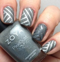 Cool gray nails - Gray and silver glitter nail polish design in diagonal stripes. Make your nails stand and out and be different with this combination of light and dark gray silver nail polish.
