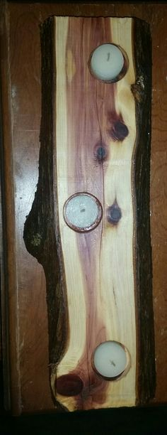 My Red cedar candle holder that I made. My father-in-law cut me out a piece of a log and I made THIS. My husband drilled the holes for me and I has to use the dremmal to smooth them and round them out for the candles to fit with a little extra room (made it look better).