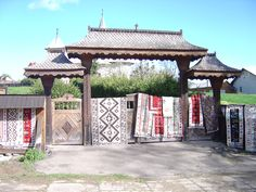 Sculpted wooden gates and colourful costumes are some of the highlights in Northern Transilvania travel. Try our guided walking holidays in Romania. Romanian People, Gazebo, Pergola, Romania Travel, Moldova, Culture Travel, Hungary, Carpets, Poland