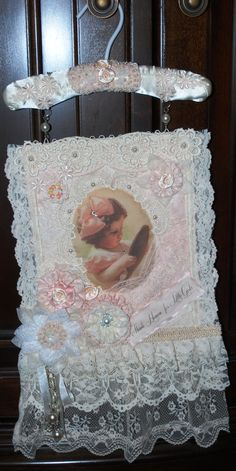 Like this idea for wall hanging - love the combination of vintage image, laces, beading and handmade flowers! :)
