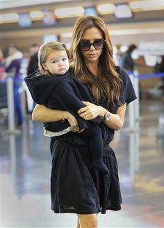 Victoria and Harper Beckham depart JFK Airport in New York on Oct. 23, 2012.