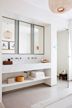 Home Interior Paint The bathroom enjoys the luxury of space and a Carrara marble vanity and bath. Boho Bathroom, Modern Bathroom, Small Bathroom, Bathroom Sets, White Bathroom, Bathroom Wall, Dream Bathrooms, Beautiful Bathrooms, Marble Bathrooms