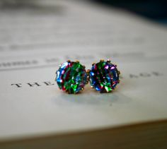Very beautiful and unusual vintage glass rhinestone jewels in a rainbow Iris color. These jewels are set in brass settings and adhered to a flat