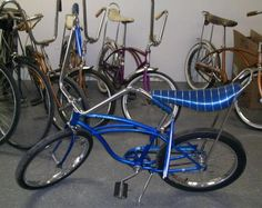 We had a blue banana seat bike just like this one we used to do tricks on; balancing while standing on the seat. Ripped my favorite corduroys doing that!