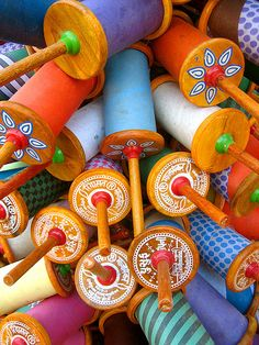 Kite season is in full swing which means that road-side guys are coating kite-string with coloured paste embedded with powdered glass so that flyers can cut each others kites. Here, empty reels are waiting to be loaded with string.  Published in Serendib magazine (Sri Lankan Airlines) in January, 2008.