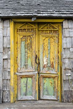Old door: Old damaged door in Castro, Chiloe Island, Chile Cool Doors, Unique Doors, The Doors Of Perception, When One Door Closes, Yellow Doors, Knobs And Knockers, Door Gate, Foto Art, Closed Doors