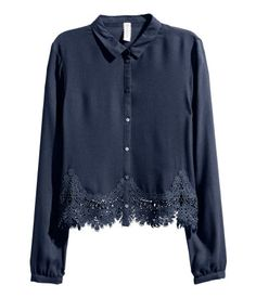 Dark blue. Short, straight-cut blouse in soft, woven viscose with a narrow collar, buttons at front, and long sleeves with narrow cuffs with buttons. Wide