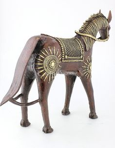 This Beautiful Golden slim Elephant with two riders on its back is an exclusive piece of dhokra art work. This piece is made as one piece only, no artistic work is done afterwards. #artsandcrafts #craftsofindia #indianheritage #handmade #craftsbazaar #madeinindia #artisansonline
