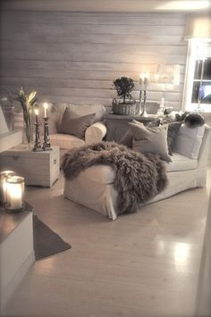 Cozy grey & white living room with lots of pillows