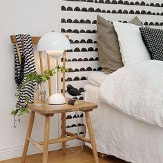 Un papier-peint en tête de lit