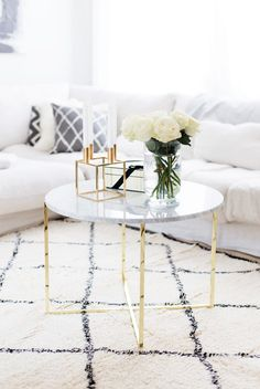 Marble Coffee table with gold base via Alexa Dagmar