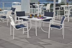 La'Stratta Patterned Aluminum Dining Table with South Beach Dining Chairs by Tropitone.