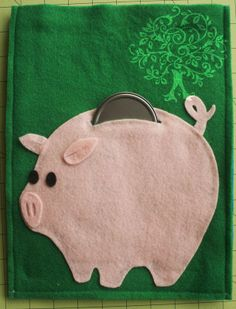 """piggy bank... the """"money"""" goes into a zip pouch on the other side!"""