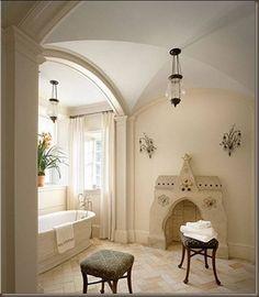 master bath stand alone porcelain tub barrel vaulted ceiling lantern fireplace