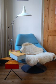 Blue Lounge Chair w/ an interesting light, side table
