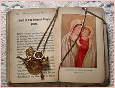 growing up Catholic...my necklace & First Communion 1954 prayer book  ~Mary~