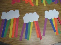 Rainbows **I put colored dots in crayon on back of the cloud for the kids to match the colored construction paper strips too**