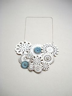 White Leather Spring Blossom Necklace With Tiny Blue Flowers by Lemka's B-side. Featured in Sweet Paul Mag Spring 2012. (Love this Etsy seller in general)