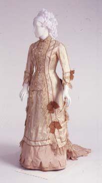 Evening Dress, American, ca. 1875-1880. Silk satin, silk taffeta ribbon, silk machine lace, silk taffeta.